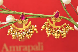 Shop Amrapali silver gold plated earrings online in USA with pearl and golden beads. Complete your traditional style with exquisite silver gold plated jewelry from Pure Elegance Indian fashion store in USA.-front