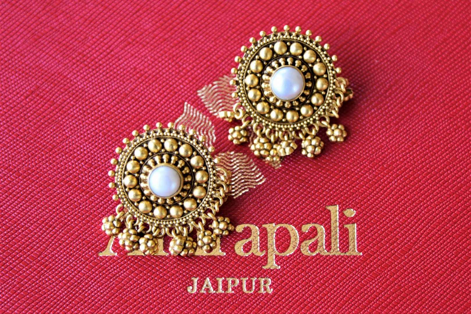 Shop beautiful Amrapali silver gold plated pearl studs online in USA with beads hangings. Elevate your ethnic attires with exquisite Indian jewelry, silver earrings, silver gold plated necklaces from Pure Elegance Indian fashion store in USA.-flatlay