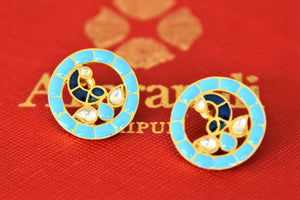Buy stunning Amrapali silver gold plated enamel peacock earrings online in USA. Shop exquisite Amrapali jewelry in USA from Pure Elegance Indian fashion store. Choose from a variety of silver gold plated earrings, gold plated necklaces, silver jewellery. also available online.-flatlay