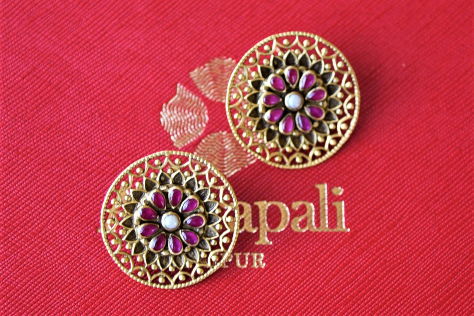 Buy stunning amethyst and pearl floral silver gold plated studs online in USA. Elevate your ethnic attires with exquisite Indian jewelry, silver earrings, silver gold plated necklaces from Pure Elegance Indian fashion store in USA.-flatlay