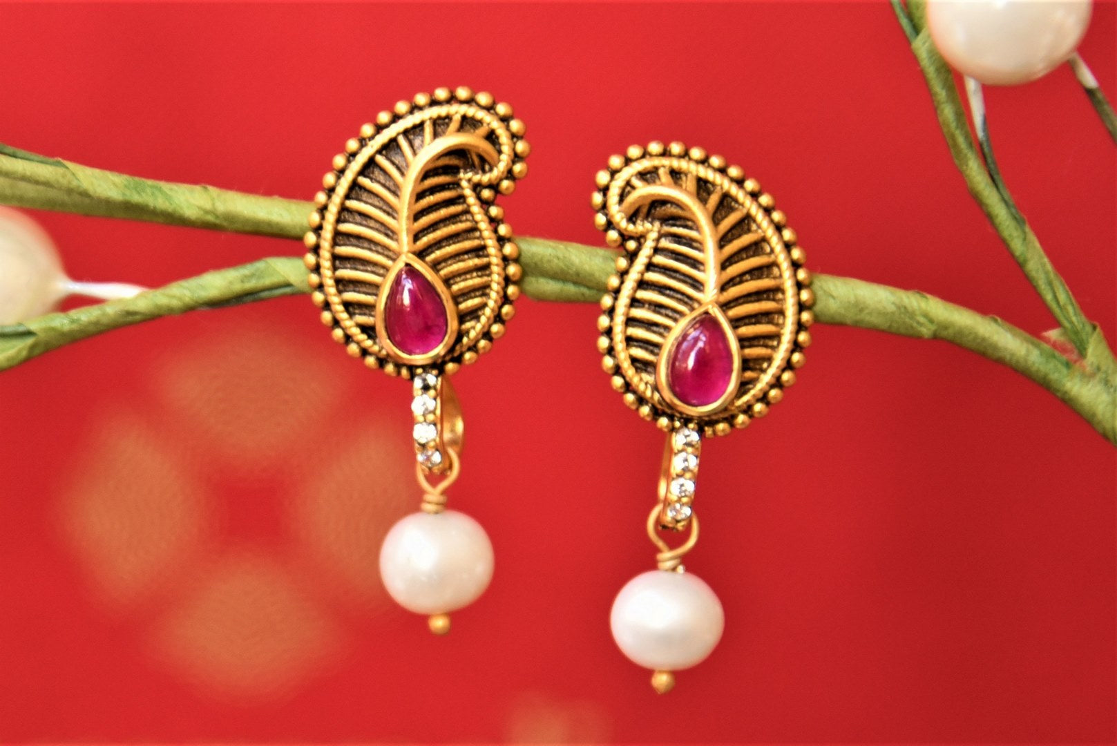 Shop Amrapali silver gold plated ambi earrings online in USA with pearl drop. Complete your traditional style with exquisite silver gold plated jewelry from Pure Elegance Indian fashion store in USA.-front