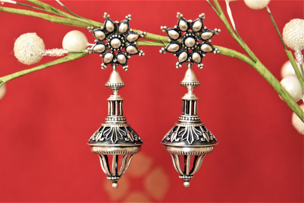 Buy beautiful Amrapali flower top antique silver drop earrings online in USA. Complete your traditional style with exquisite silver gold plated jewelry from Pure Elegance Indian fashion store in USA.-front