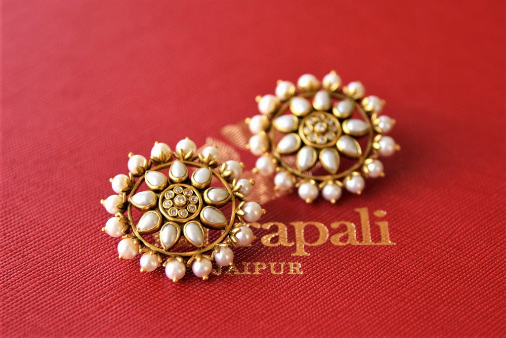 Shop stunning silver gold plated pearl floral studs online in USA. Elevate your ethnic attires with exquisite Indian jewelry, silver earrings, silver gold plated necklaces from Pure Elegance Indian fashion store in USA.-flatlay