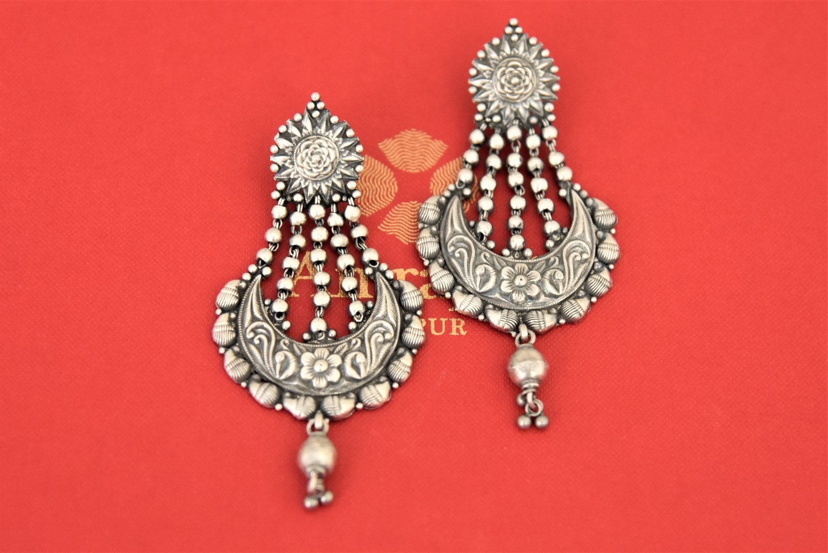 Buy Amrapali antique silver chandelier earrings online in USA. Complete your traditional style with exquisite silver jewelry from Pure Elegance Indian fashion store in USA.-flatlay