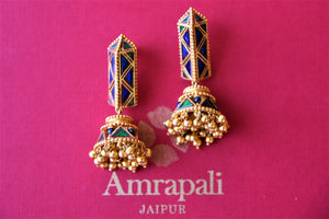 Shop beautiful Amrapali blue and green glass silver gold plated jhumki earrings online in USA. Elevate your ethnic attires with exquisite Indian jewelry, silver earrings, silver gold plated necklaces from Pure Elegance Indian fashion store in USA.-flatlay