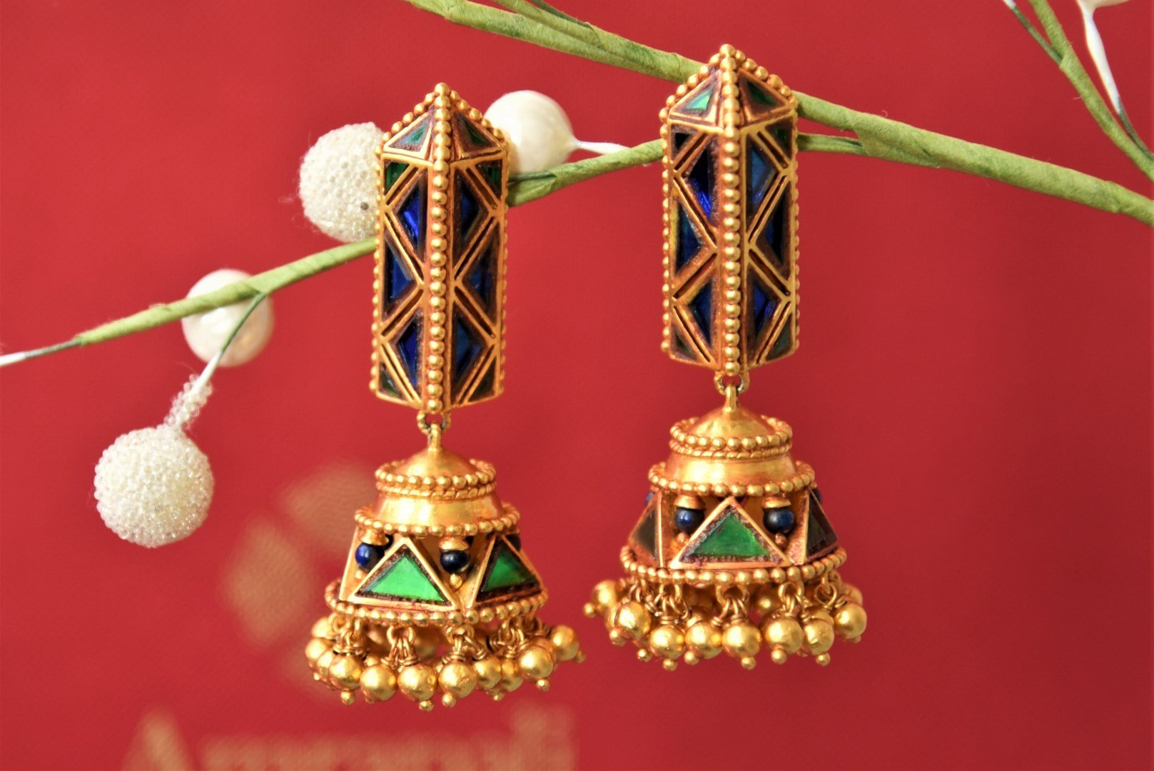 Shop beautiful Amrapali blue and green glass silver gold plated jhumki earrings online in USA. Elevate your ethnic attires with exquisite Indian jewelry, silver earrings, silver gold plated necklaces from Pure Elegance Indian fashion store in USA.-front