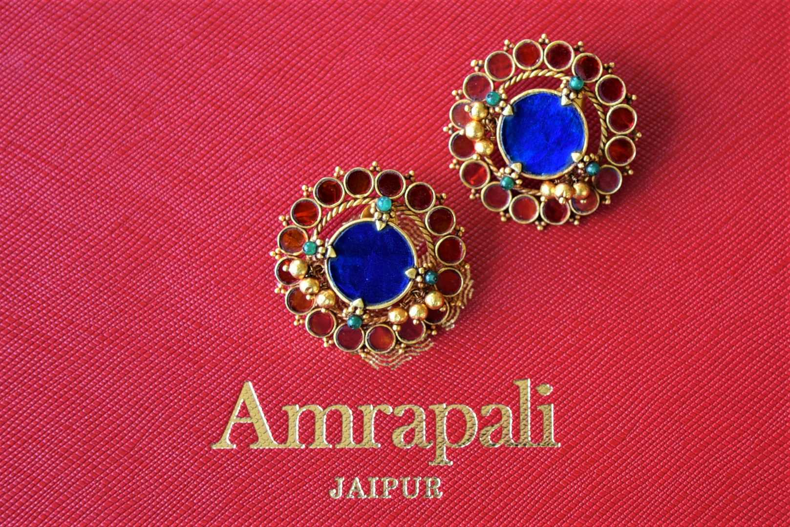 Shop Amrapali blue glass silver gold stud earrings online in USA. Elevate your ethnic attires with exquisite Indian jewelry, silver earrings, silver gold plated necklaces from Pure Elegance Indian fashion store in USA.-flatlay