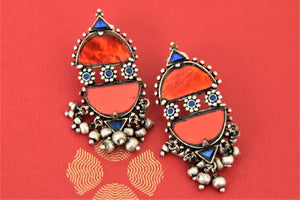 Shop Amrapali red and blue glass silver earrings online in USA with silver beads. Complete your traditional style with exquisite silver jewelry from Pure Elegance Indian fashion store in USA.-flatlay
