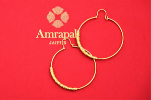 Shop Amrapali elegant silver gold plated hoop earrings online in USA. Choose from a beautiful range of Indian jewellery, silver jewelry, silver earrings, gold plated jewelry from Pure Elegance Indian fashion store in USA.-flatlay