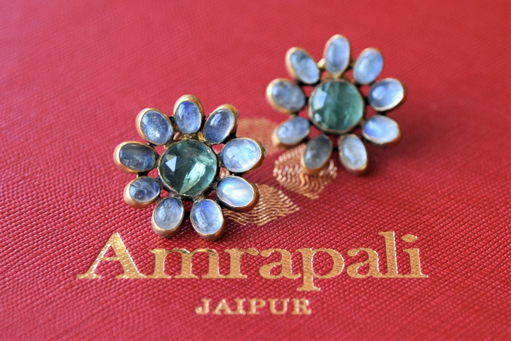 Buy Amrapali silver gold plated blue stone flower stud earrings online in USA. Elevate your ethnic attires with exquisite Indian jewelry, silver gold plated earrings, silver gold plated necklaces from Pure Elegance Indian fashion store in USA.-flatlay