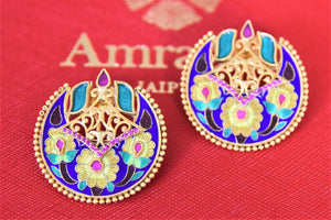 Shop exquisite Amrapali silver gold plated blue enamel studs online in USA. Shop exquisite Amrapali jewelry in USA from Pure Elegance Indian fashion store. Choose from a variety of silver gold plated earrings, gold plated necklaces, silver jewellery. also available online.-flatlay