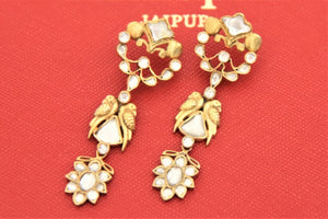 Shop exquisite Amrapali silver gold plated glass drop earrings online in USA. Give yourself a beautiful traditional makeover this wedding season with exquisite gold plated jewellery, silver jewelry from Pure Elegance Indian fashion boutique in USA.-flatlay