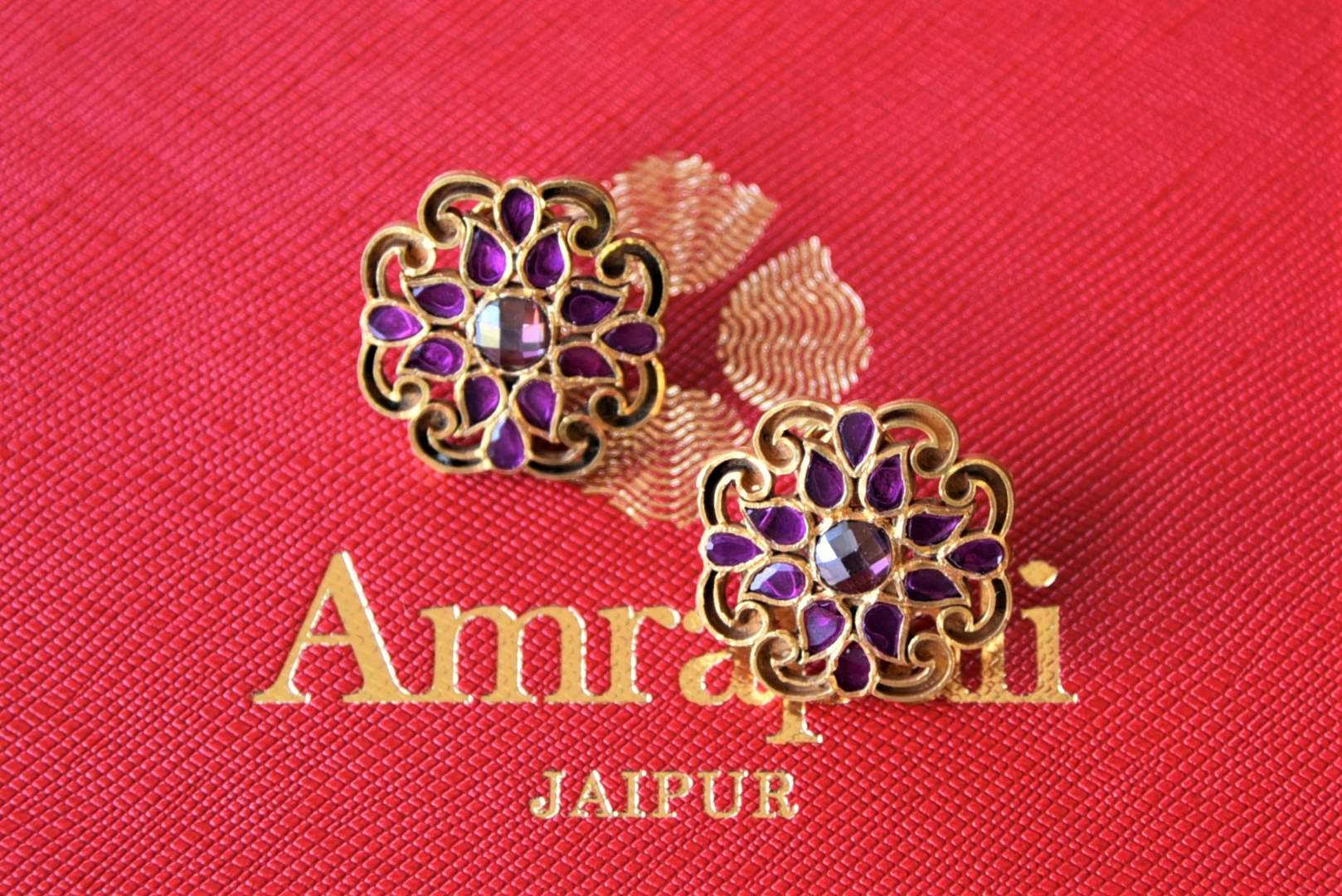 Shop Amrapali purple glass silver gold plated flower stud earrings online in USA. Elevate your ethnic attires with exquisite Indian jewelry, silver gold plated earrings, silver gold plated necklaces from Pure Elegance Indian fashion store in USA.-flatlay