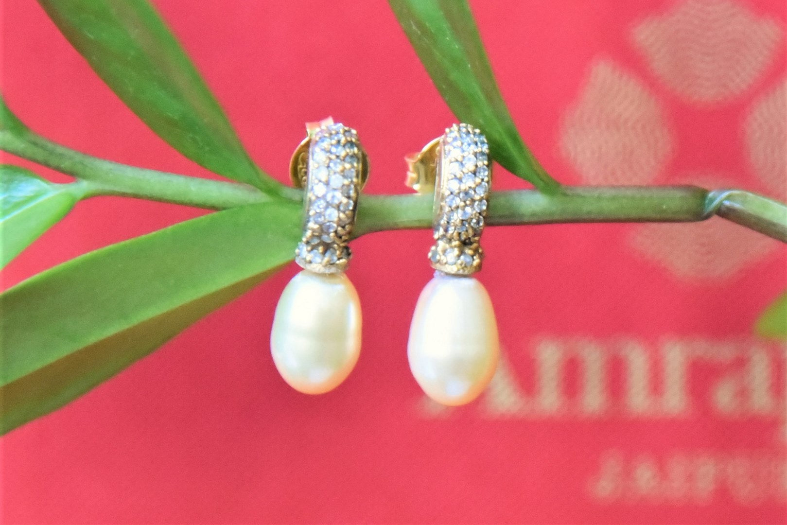 Shop Amrapali elegant silver gold plated zircon earrings online in USA with pearl drop. Complete your traditional style with exquisite silver gold plated jewelry from Pure Elegance Indian fashion store in USA.-front