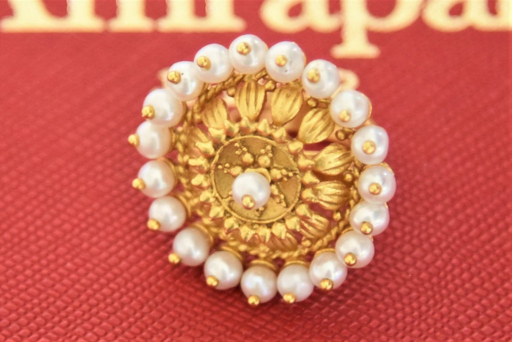 Shop beautiful Amrapali silver gold plated floral pearl ring online in USA. Give yourself a beautiful traditional makeover this wedding season with exquisite gold plated jewellery, silver jewelry from Pure Elegance Indian fashion boutique in USA.-flatlay