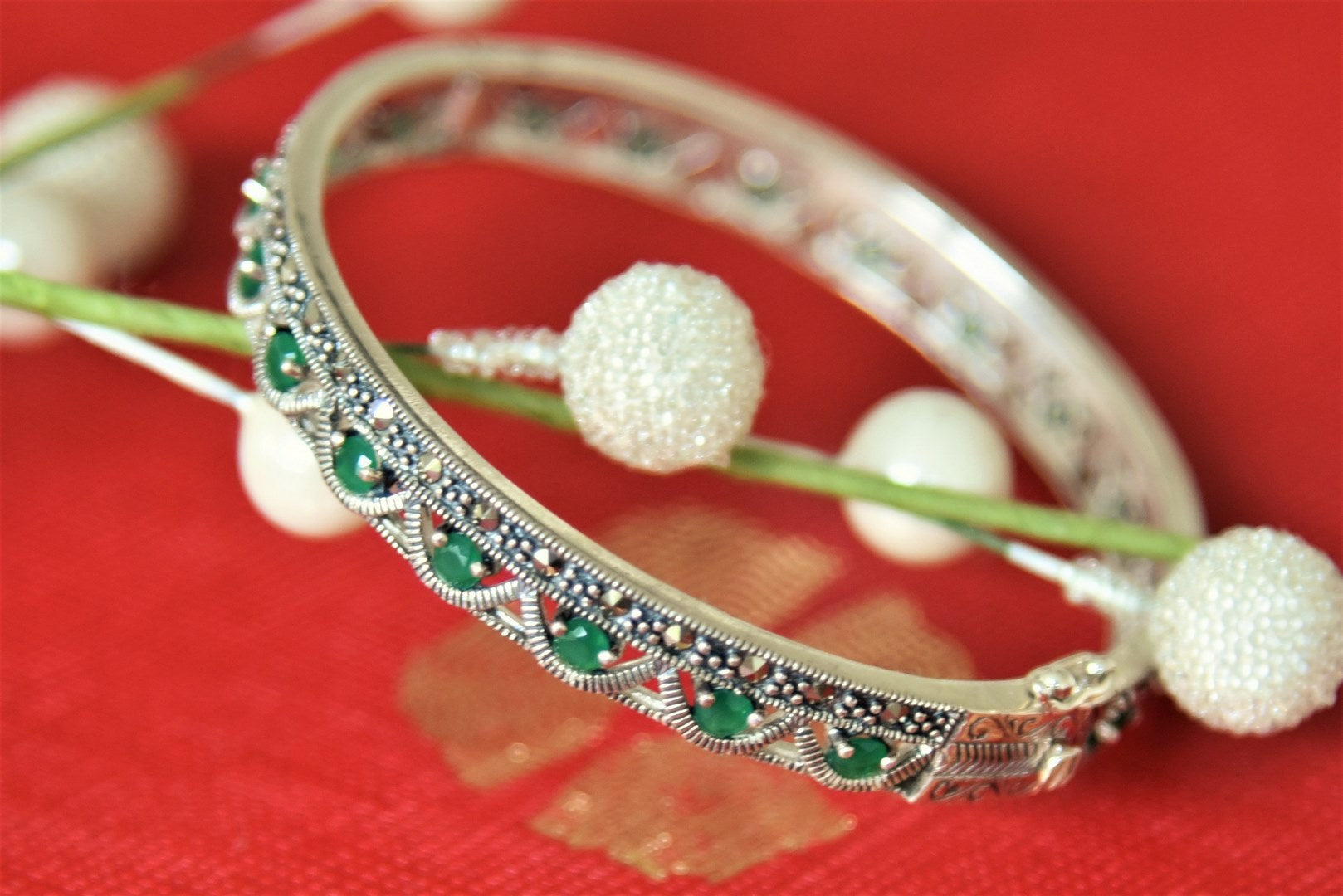 Shop Amrapali green stones silver bangle online in USA. Give yourself a beautiful traditional makeover this wedding season with exquisite gold plated jewellery, silver jewelry from Pure Elegance Indian fashion boutique in USA.-front