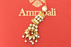 Buy Amrapali silver gold plated glass and pearl floral maangtikka online in USA. Give yourself a beautiful traditional makeover this wedding season with exquisite gold plated jewellery, silver jewelry from Pure Elegance Indian fashion boutique in USA.-flatlay
