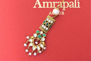Shop Amrapali silver gold plated green stone and pearl floral maangtikka online in USA. Give yourself a beautiful traditional makeover this wedding season with exquisite gold plated jewellery, silver jewelry from Pure Elegance Indian fashion boutique in USA.-flatlay