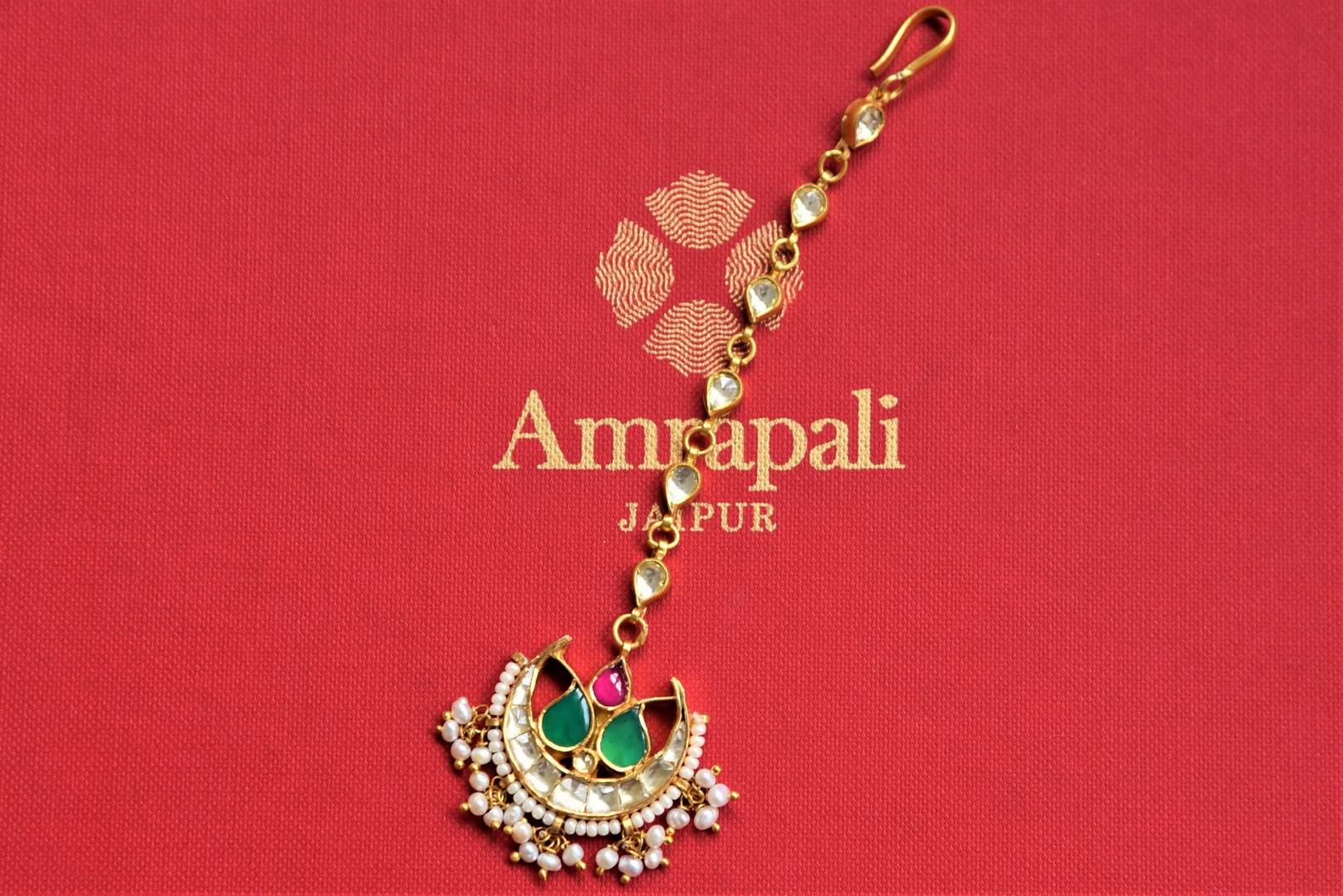 Buy silver gold plated crescent kundan maangtikka online in USA. Add spark to your festive style with beautiful silver gold plated jewelry in USA from Pure Elegance Indian fashion store.-flatlay