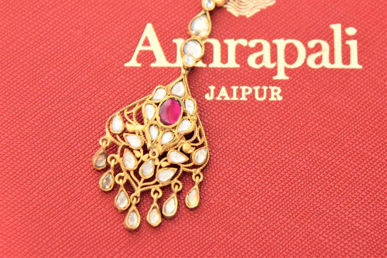 Shop Amrapali silver gold plated glass maangtikka online in USA. Give yourself a beautiful traditional makeover this wedding season with exquisite gold plated jewellery, silver jewelry from Pure Elegance Indian fashion boutique in USA.-flatlay