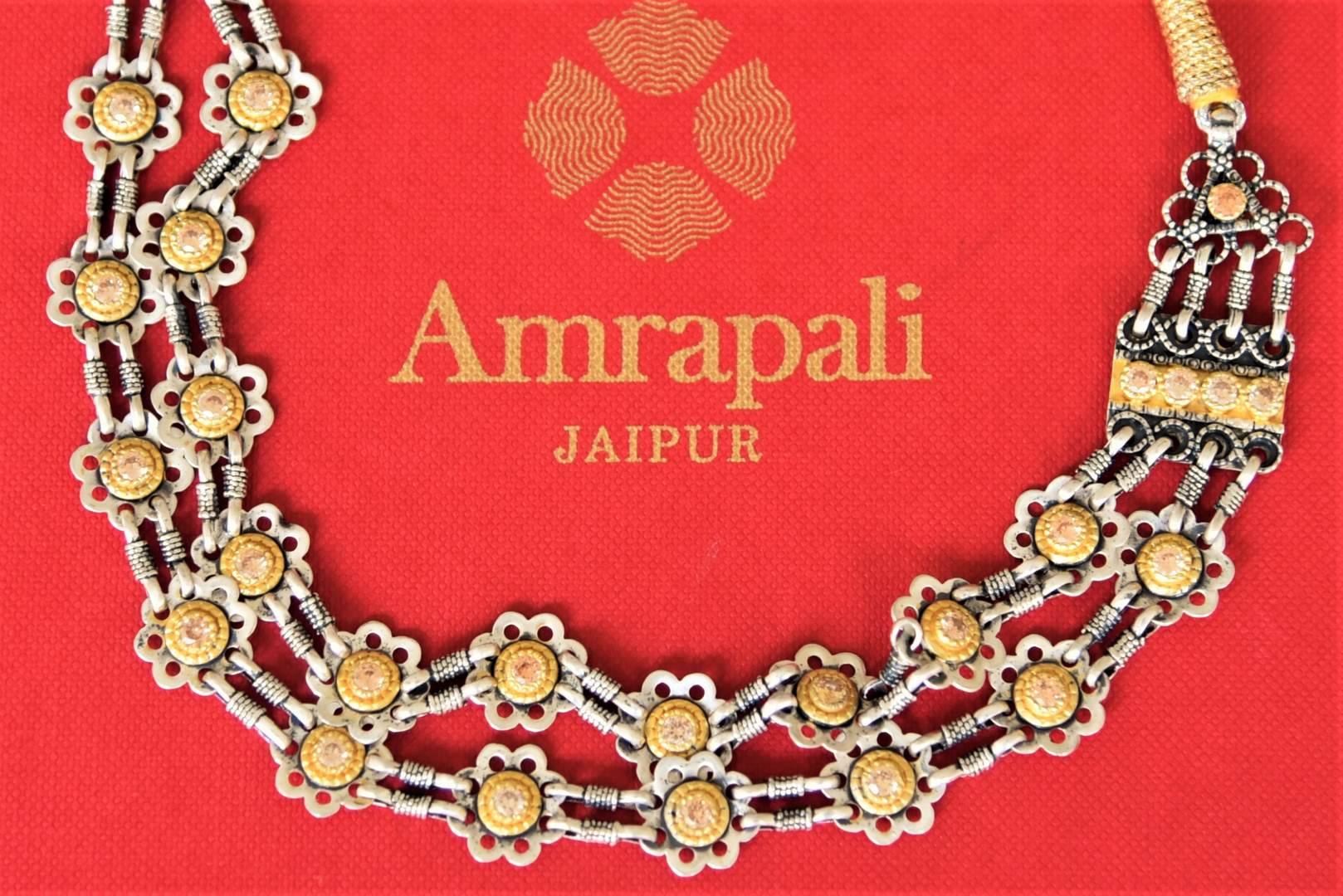 Shop Amrapali silver gold plated two-tone necklace online in USA. Add spark to your festive style with beautiful silver gold plated necklace, fashion jewelry in USA from Pure Elegance Indian fashion store.-flatlay