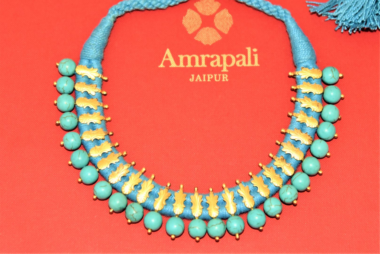 Buy beautiful Amrapali silver gold plated blue thread necklace online in USA with turquoise stones. Enhance your ethnic attires with exquisite Amrapali silver jewelry, silver necklace, silver gold plated jewelry, silver earrings from Pure Elegance Indian fashion store in USA.-flatlay
