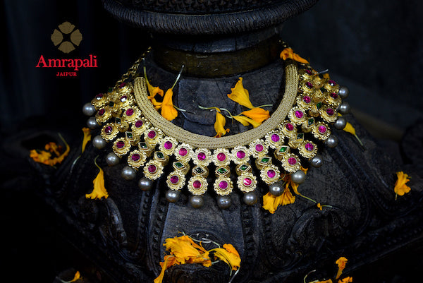 Shop Amrapali heavy silver gold plated ruby and emerald necklace online in USA. Enhance your ethnic attires with exquisite Amrapali silver gold plated jewelry, gold plated necklace, gold plated earrings from Pure Elegance Indian fashion store in USA.-front