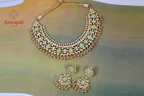Buy exquisite Amrapali silver gold plated meenakari and glass necklace set online in USA. Enhance your ethnic attires with exquisite Amrapali silver gold plated jewelry, silver gold plated necklace from Pure Elegance Indian fashion store in USA.-flatlay