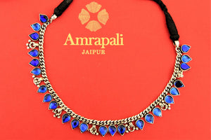 Buy beautiful Amrapali blue glass leaf silver thread necklace online in USA. Choose from a beautiful range of Indian jewelry, silver necklaces, silver earrings, gold plated jewelry from Pure Elegance Indian fashion store in USA.-flatlay