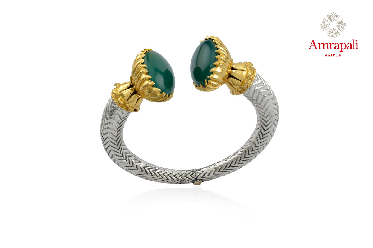Shop silver gold plated two-tone green stone bracelet online in USA. Enhance your ethnic attires with exquisite Amrapali silver gold plated jewelry, silver gold plated necklace from Pure Elegance Indian fashion store in USA.-front