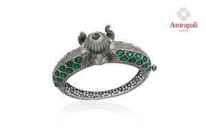 Shop stunning Amrapali green stone heavy silver bangle online in USA. Enhance your ethnic attires with exquisite Amrapali silver jewelry, silver bangle from Pure Elegance Indian fashion store in USA.-front