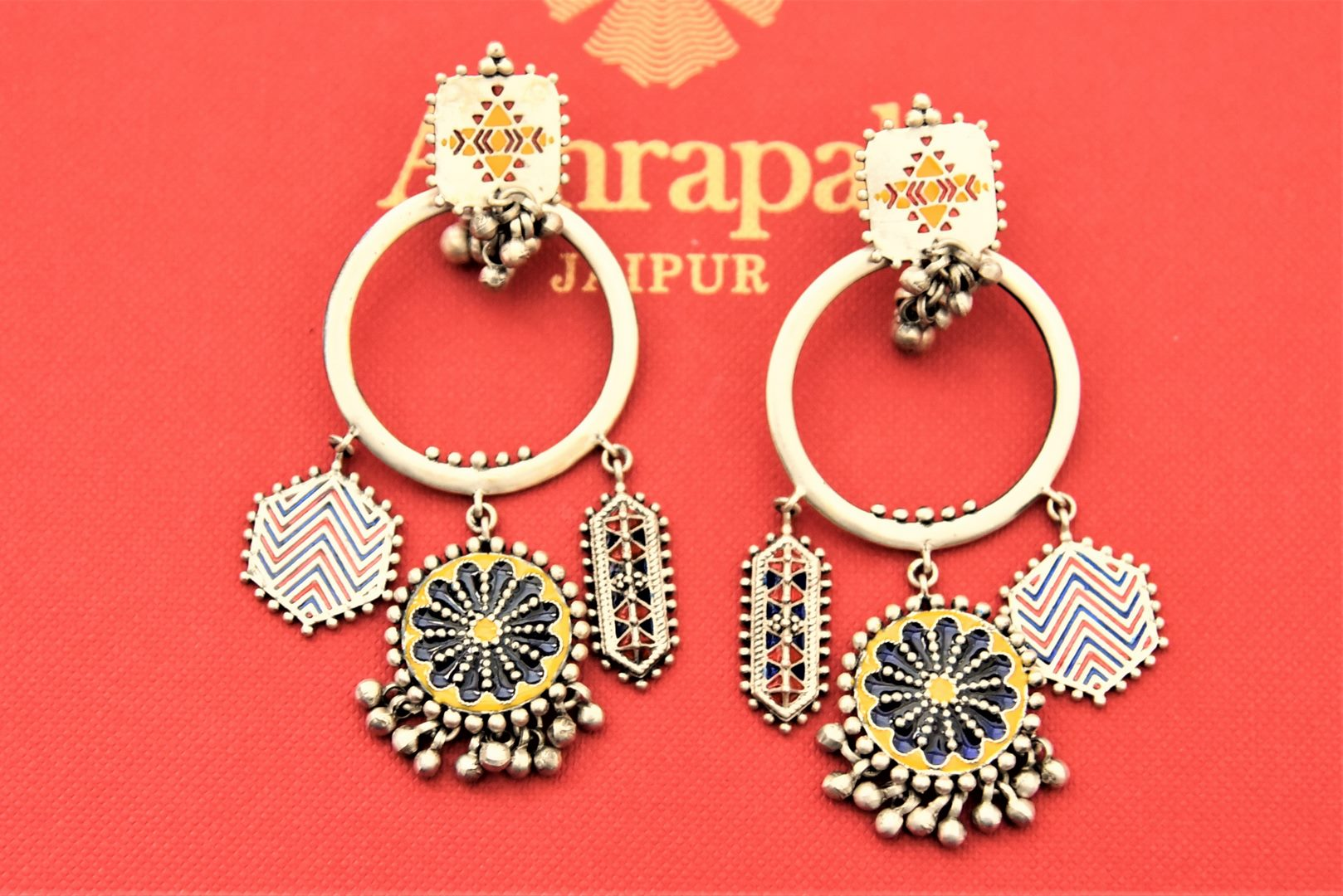 Shop gorgeous Amrapali silver hoop earrings online in USA with enamel trinkets. Enhance your ethnic attires with exquisite Amrapali silver jewelry, silver necklace, silver gold plated jewelry, silver earrings, silver bangles from Pure Elegance Indian fashion store in USA.-flatlay