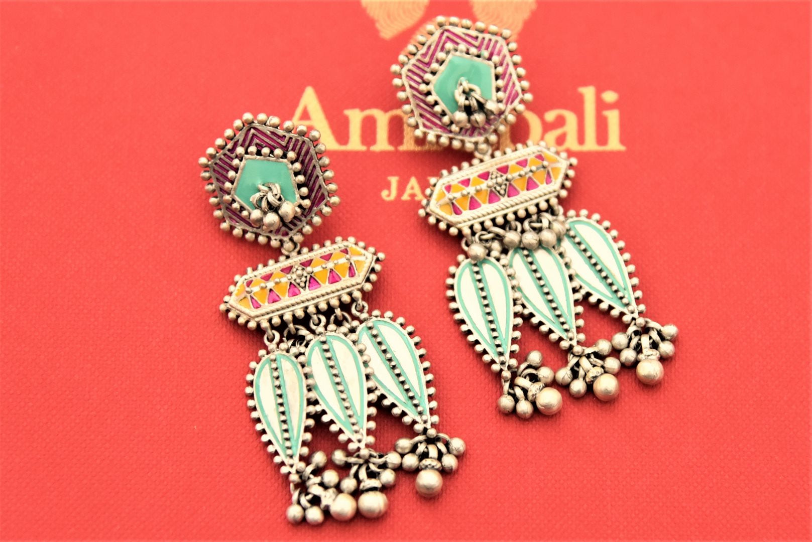 Buy gorgeous Amrapali colorful enamel silver ghungroo earrings online in USA. Enhance your ethnic attires with exquisite Amrapali silver jewelry, silver necklace, silver gold plated jewelry, silver earrings, silver bangles from Pure Elegance Indian fashion store in USA.-flatlay