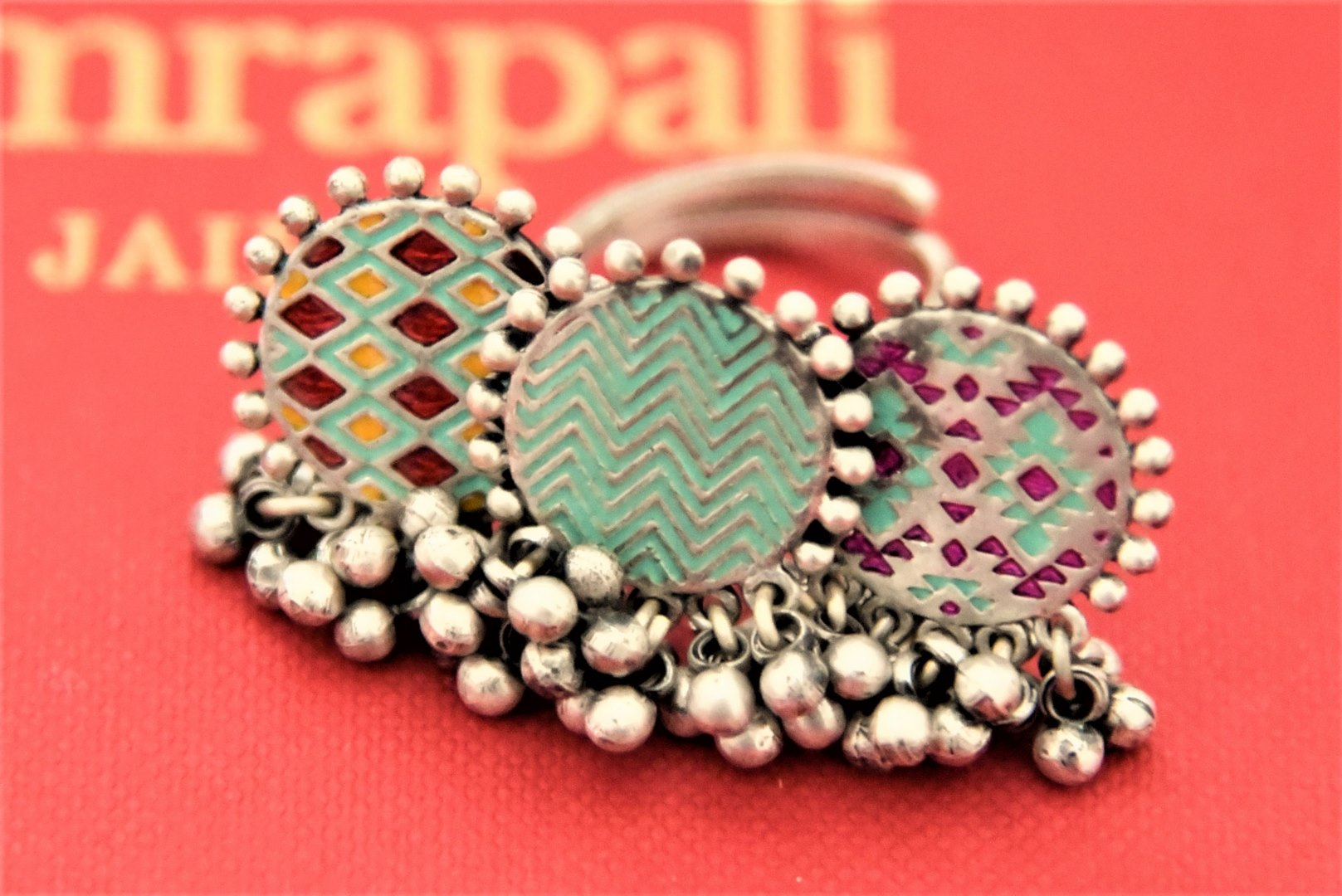 Buy Amrapali colorful enamel three coin silver ghungroo ring online in USA. Enhance your ethnic attires with exquisite Amrapali silver jewelry, silver necklace, silver gold plated jewelry, silver earrings, silver bangles from Pure Elegance Indian fashion store in USA.-full view