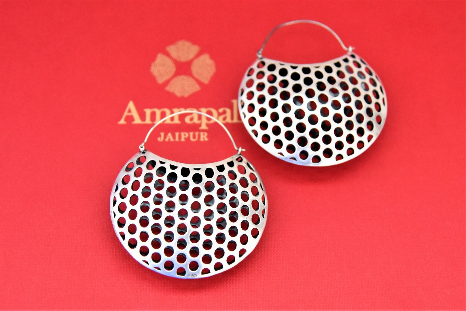 Buy elegant Amrapali silver basket earrings online in USA. Choose from a beautiful range of Indian jewelry, silver jewelry, silver earrings, gold plated jewelry from Pure Elegance Indian fashion store in USA.-flatlay