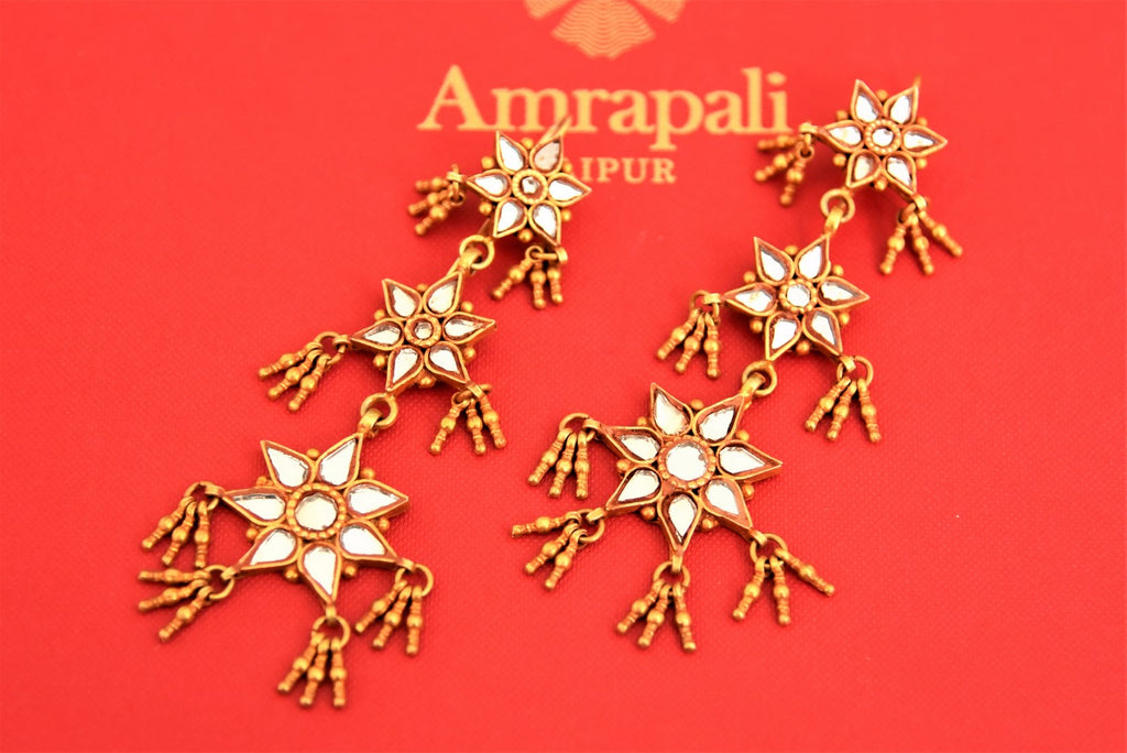 Buy stunning Amrapali silver gold plated glass flower motifs drop earrings online in USA. Choose from a beautiful range of Indian jewelry, silver necklaces, silver earrings, gold plated jewelry from Pure Elegance Indian fashion store in USA.-flatlay