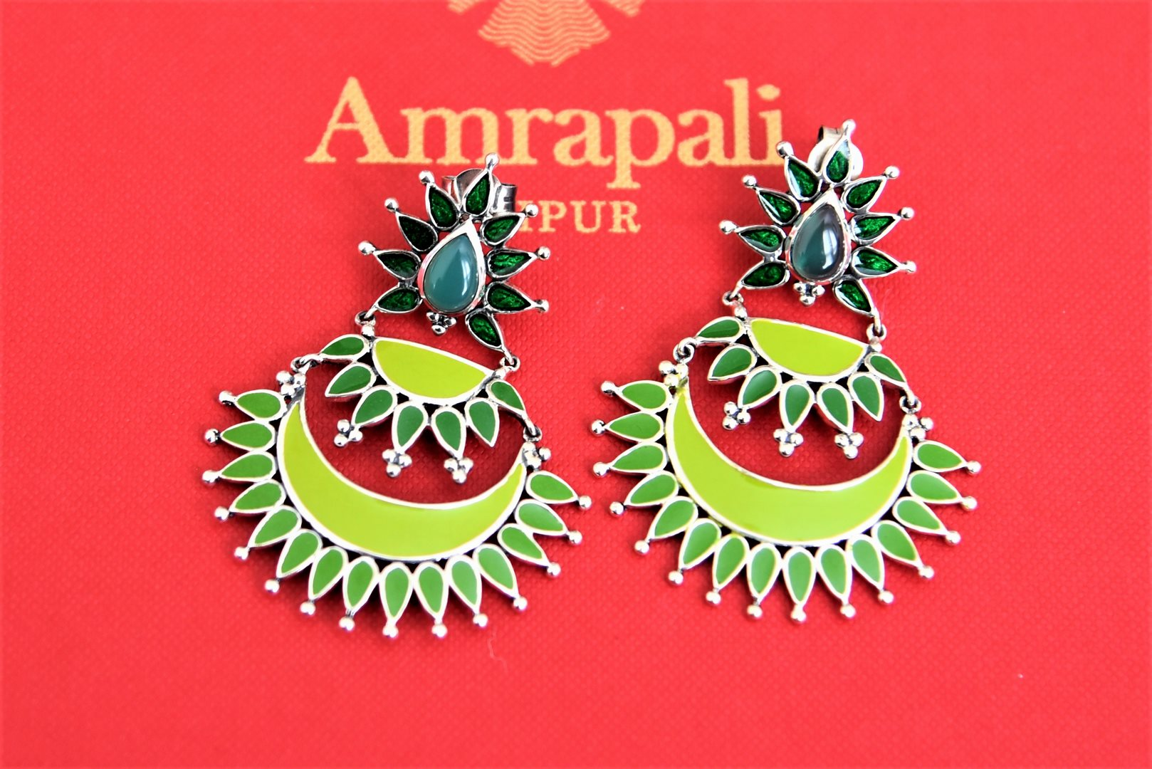 Shop stunning Amrapali two-tone green enamel layered silver chandbali earrings online in USA. Choose from a beautiful range of Indian jewelry, silver jewelry, silver earrings, gold plated jewelry from Pure Elegance Indian fashion store in USA.-flatlay