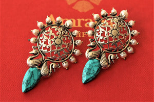 Shop gorgeous silver floral top earrings online in USA with blue drop stone. Elevate your ethnic outfits with beautiful silver jewelry, silver gold plated jewellery, Bollywood jewelry, silver gold plated earrings, gold plated necklaces from Pure Elegance Indian fashion store in USA.-flatlay