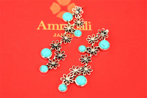 Shop gorgeous Amrapali silver floral drop earrings online in USA with turquoise stones. Choose from a beautiful range of Indian jewelry, silver necklaces, silver earrings, gold plated jewelry from Pure Elegance Indian fashion store in USA.-flatlay