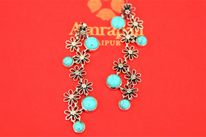 Shop gorgeous Amrapali silver floral drop earrings online in USA with turquoise stones. Choose from a beautiful range of Indian jewelry, silver necklaces, silver earrings, gold plated jewelry from Pure Elegance Indian fashion store in USA.-front