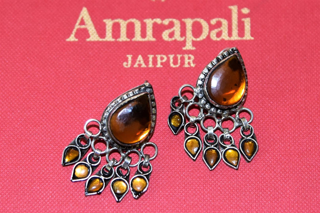 Shop gorgeous Amrapali yellow glass leaf silver earrings online in USA. Complete your festive look with exclusive silver gold plated jewelry, gold plated earrings, silver jewelry, silver earrings from Pure Elegance Indian fashion store in USA.-front