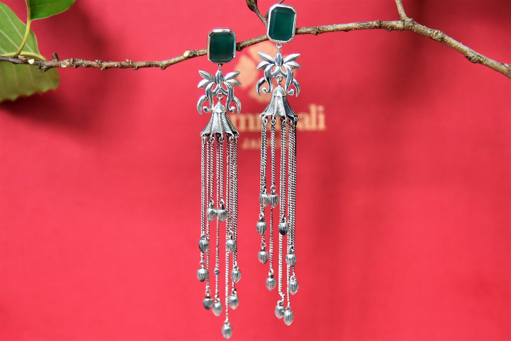 Shop stunning silver tassel earrings online in USA with green stone top. Complete your festive look with exclusive silver gold plated jewelry, gold plated earrings, silver jewelry, silver earrings from Pure Elegance Indian fashion store in USA.-front