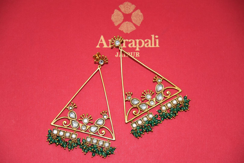 Shop stunning Amrapali silver gold plated triangle shape glass earrings online in USA with green beads. Complete your festive look with exclusive silver gold plated jewelry, gold plated earrings, silver jewelry, silver earrings from Pure Elegance Indian fashion store in USA.-front