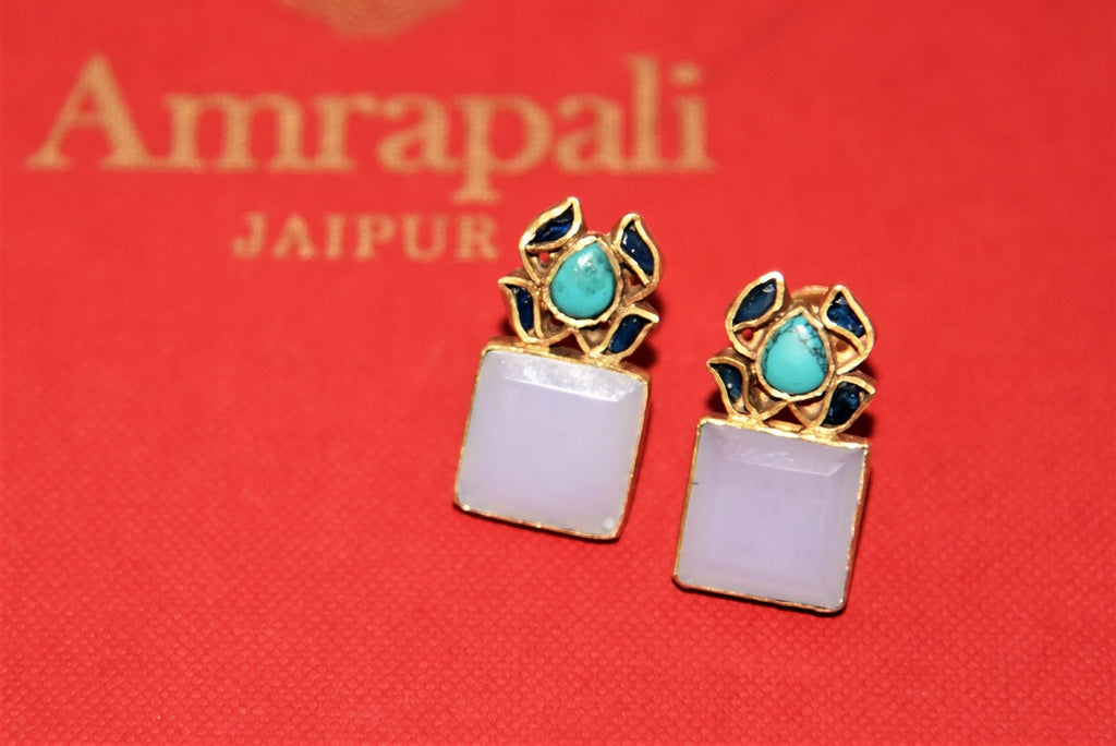 Shop stunning Amrapali silver gold plated stone earrings online in USA. Complete your festive look with exclusive silver gold plated jewelry, gold plated earrings, silver jewelry, silver earrings from Pure Elegance Indian fashion store in USA.-flatlay