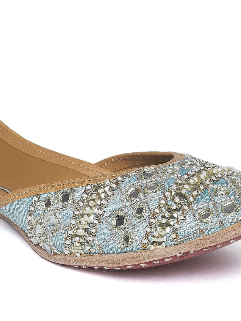 Shop pale blue sequin, bead and mirror embroidery jutti online in USA. Grab beautiful designer footwear and ethnic juttis in USA from Pure Elegance Indian fashion store in USA. Enhance your ethnic attires with exquisite accessories available on our online store.-closeup