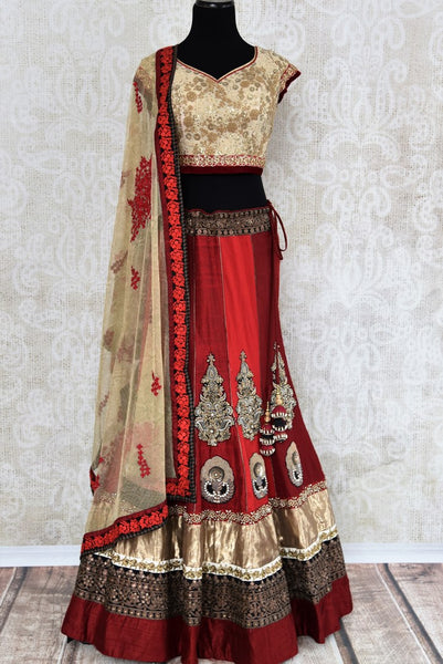 Buy designer red and gold raw silk embroidered lehenga online in USA with dupatta. Find more such exquisite Indian designer wedding lehengas in USA at Pure Elegance Indian fashion store. Shop now.-full view