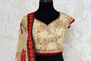 Buy designer red and gold raw silk embroidered lehenga online in USA with dupatta. Find more such exquisite Indian designer wedding lehengas in USA at Pure Elegance Indian fashion store. Shop now.-blouse front