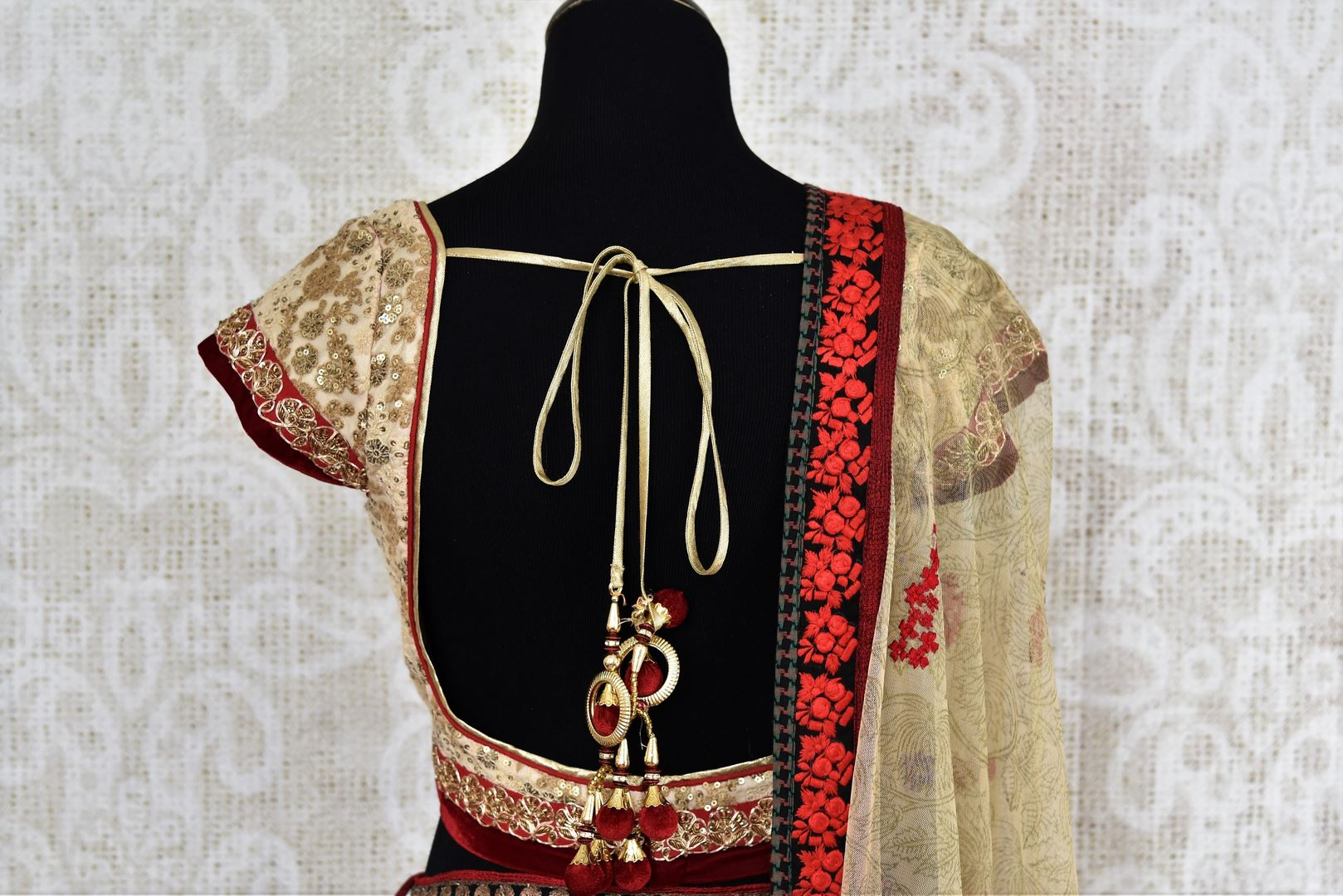 Buy designer red and gold raw silk embroidered lehenga online in USA with dupatta. Find more such exquisite Indian designer wedding lehengas in USA at Pure Elegance Indian fashion store. Shop now.-back