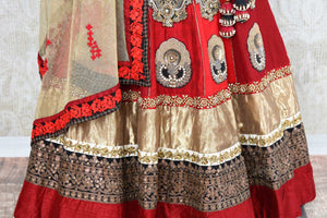 Buy designer red and gold raw silk embroidered lehenga online in USA with dupatta. Find more such exquisite Indian designer wedding lehengas in USA at Pure Elegance Indian fashion store. Shop now.-details