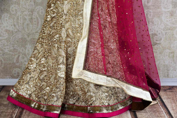 Buy Gold Net Lehenga online in USA with pink blouse and dupatta from Pure Elegance. Our store brings you stylish designer Indian Lehenga choli for every occasion.-skirt